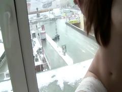 brunett juvenile hottie teasing in window