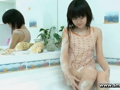 cute youthful oriental aliona plays alone in the