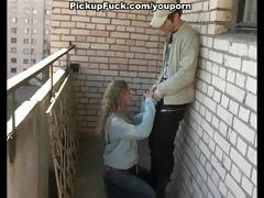 youthful blonde sucking on the veranda