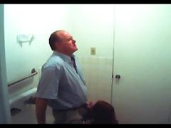 fake spy redhead gives old guy head in baths