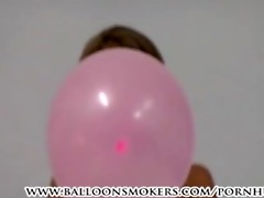 legal age teenager blows up pink balloons in
