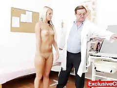 old doctor checks youthful golden-haired girl