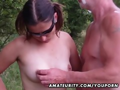 dilettante girlfriend sucks outdoor with giant