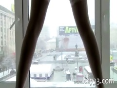 brunette hair youthful glamour teasing in window