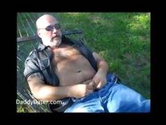shaggy dad bear jerking off on a sunny day